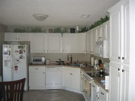 what to put on top of your kitchen cabinets what ideas do you have on what to put on top of kitchen
