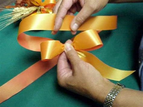 How To Make A Ribbon Bow Out Of Paper - how to make a bow out of ribbon for a gift get the