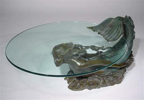 1214 mermaid figured patinated bronze glass top coffee