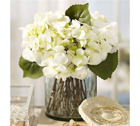 faux white hydrangea arrangement in glass vase pottery barn
