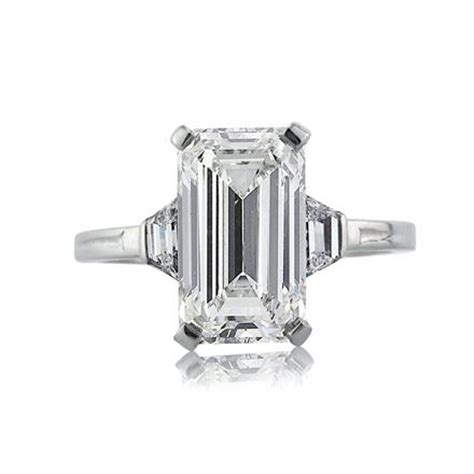 3 98ct emerald cut three engagement ring