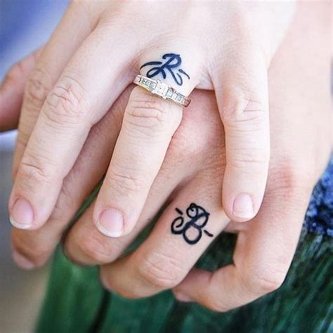 couple ring tattoo 40 sweet meaningful wedding ring tattoos