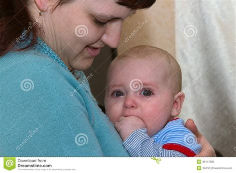 comforting a crying baby mother soothing crying baby royalty free stock photography