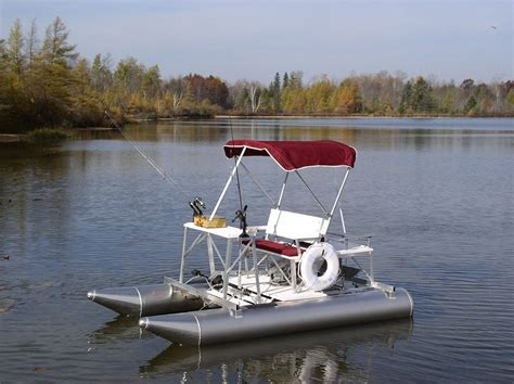 fishing boat vs pontoon the aqua cycle 15 pontoon paddle boat can also be equipped