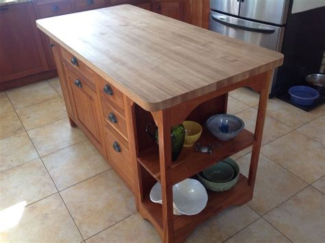 hand crafted custom designed cherry island with maple butcher block top by moose pond