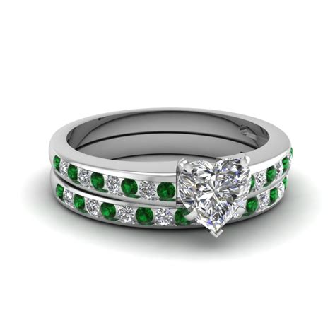 channel with emerald wedding set in 14k