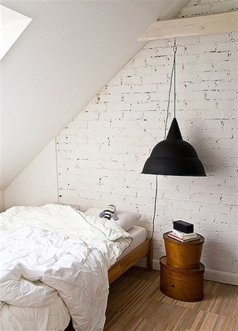 designer bedrooms with exposed brick walls