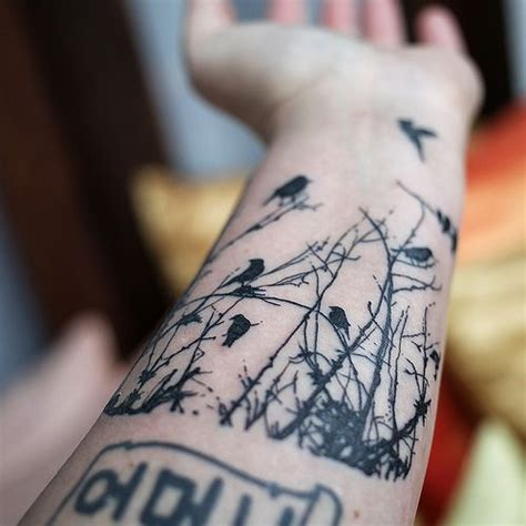 tattooed heart jungle vibe 40 genuinely awesome bird tattoos mpora