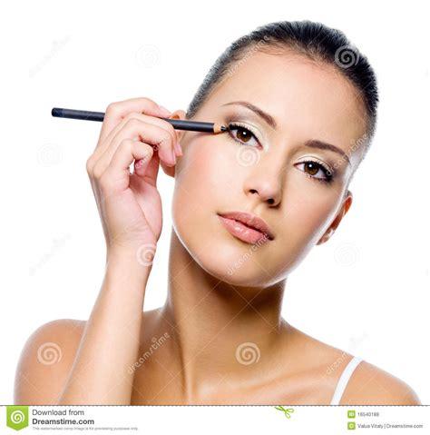 Eyeliner Pensil applying eyeliner on eyelid with pensil stock photo