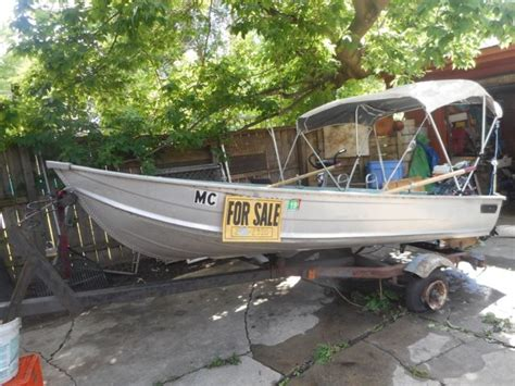 aluminum fishing boat and motor used aluminum fishing boat w gas outboard motor n electric