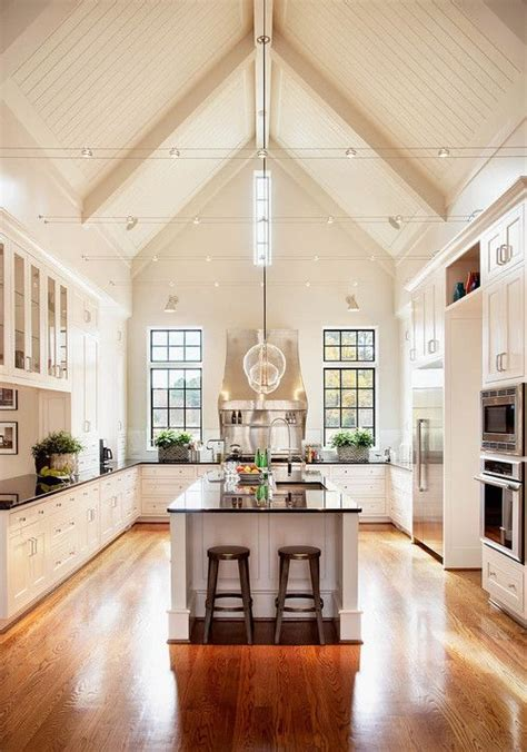 Cathedral Ceiling Kitchen Lighting Ideas by This Kitchen Vaulted Ceiling Wood Floors White Cabinets