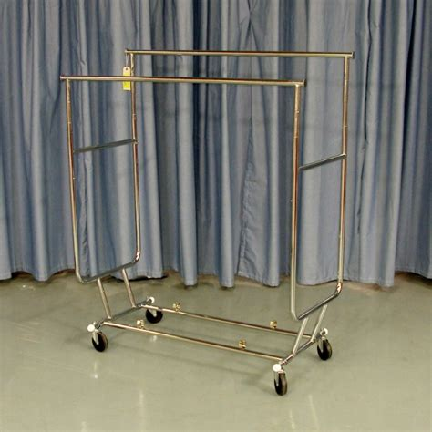 Rolling Clothes Rack by Rolling Bar Clothing Rack Store Fixture