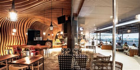 design interior cafe indonesia wavy timber slats delivering a cave like feel new six