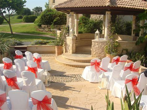 Cyprus wedding chairs and bows   Delightful Decorations
