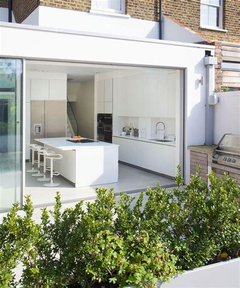 Wonderful White Or Dark Kitchen Cabinets 2017 #3: Modern-kitchen-extension-idea-with-sliding-glass-wall.jpg