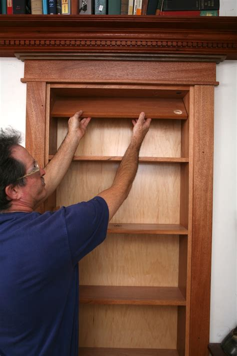 how do you make a door into a swinging bookcase hidden pivot bookcase installation thisiscarpentry