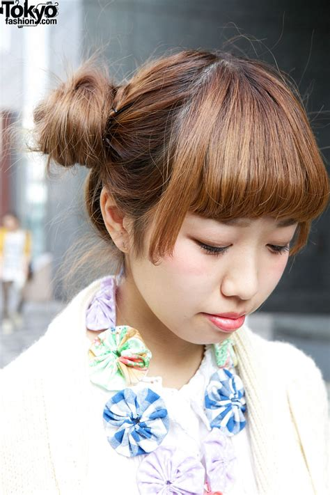 Japanese Hairstyles Buns | japanese girl s double bun hairstyle knit sweater