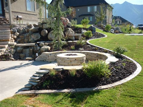 landscaping salt lake city utah backyard playgrounds trolines in the ground rock water feature play rocks basketball