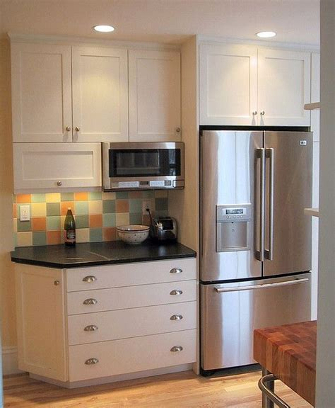 storage above kitchen cabinets 25 best ideas about microwave storage on