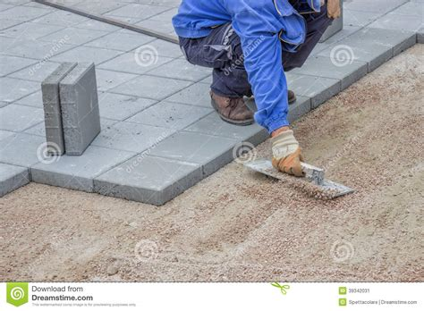 laying gravel in backyard working on gravel flattening before lay patio pavers stock photo image 39342031