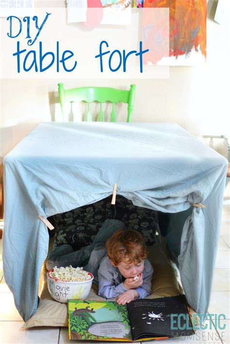 kitchen table fort for kids maggie may s diy one sheet table fort eclectic momsense