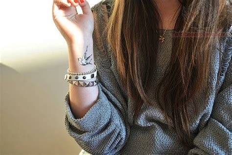 swallow tattoos on wrist images designs
