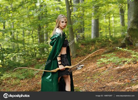 imagenes de personas mitologicas beautiful female elf archer in the forest hunting with a