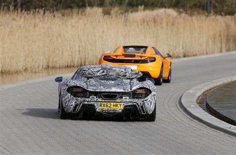 camo mclaren mclaren p1 in camo turns up at f1 car debut autoevolution