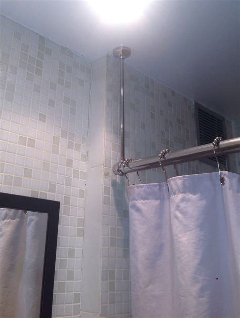 how to hang curtain rods from ceiling bathroom how can i patch the ceiling and rehang a shower