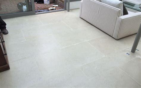 Laying Limestone Floor Tiles by Rescuing A Limestone Floor P Mac