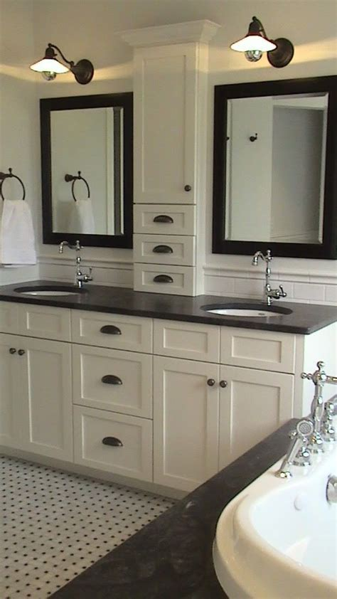 bathroom with 2 sinks storage between the sinks and nothing on the counter