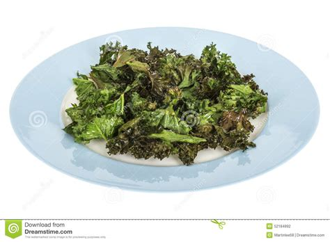 Crunchy Green Kale Ready Stock home made crispy baked kale crisps or chips served on blue