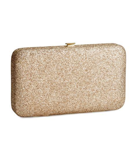 h m mobile phone clutch bag in metallic lyst
