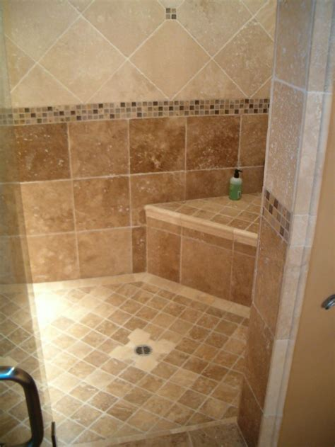 doorless curbless tile shower with river rock floor and bathroom tiles relieving tiled shower for modern bathroom