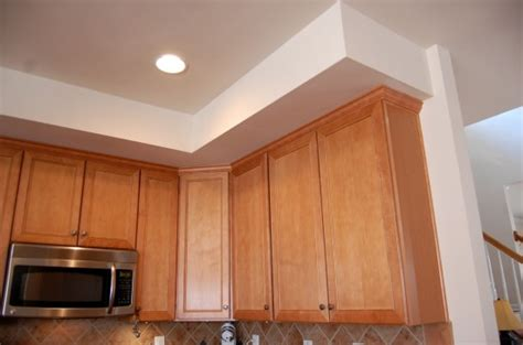 hide soffit above kitchen cabinets by adding crown molding soffit kitchen above cabinets mf cabinets