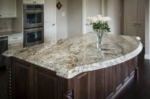 White granite with brown veining installed on dark cabinets in