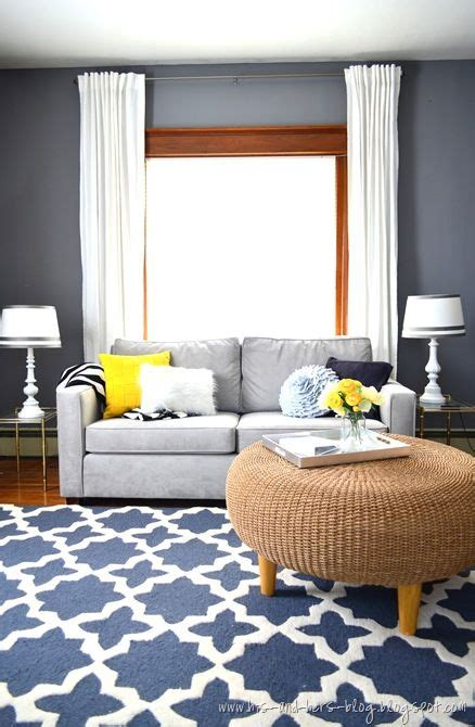 gray couch blue rug blue  yellow pillowsright