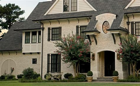 earth tone exterior house colors exterior traditional with front door wood siding wall lighting