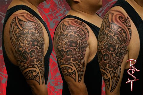 rock solid tattoo skull polynesian 1 2 sleeve clients done