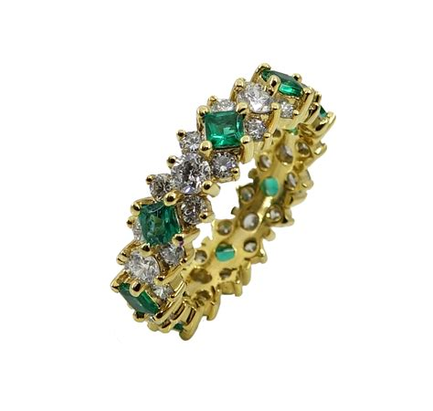 yellow gold diamond  emerald eternity band world