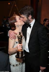 Julianne Moore kisses husband Bart Freundlich at the first