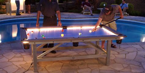 outdoor pool table features built in lighting for