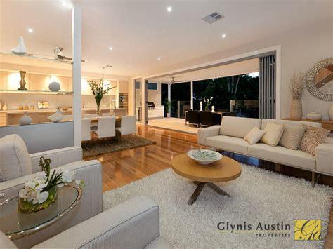 Open plan living room using cream colours with carpet & bi