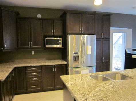 oak cabinets with light granite countertops leggo