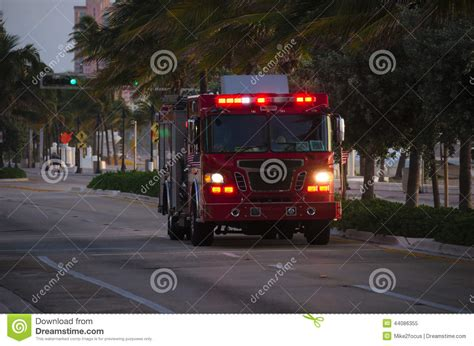 firefighter lights and sirens fire truck with flashing emergency lights at dusk stock