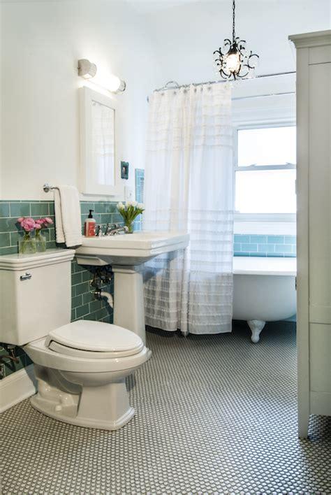 teal subway tiles transitional bathroom studio  interiors