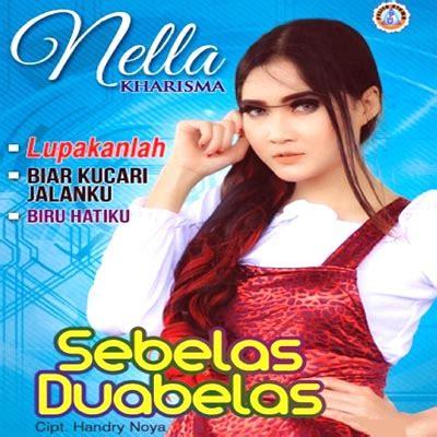Download Mp3 Nella Kharisma Hitam Putih | lirik lagu nella kharisma hitam putih fotomu waniperih