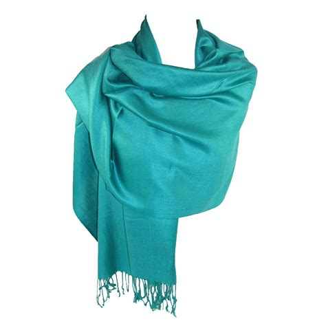 Pasmina Sing wyr only be able to wear t shirts with holes cut out or to sing quot don t stop believin