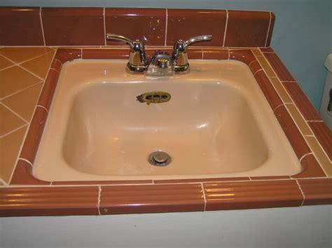 1950s bathroom sink replacing a 1950s sink