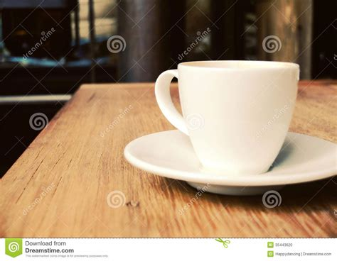 cup of coffee on table at coffee shop stock photo image